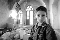 Mamon Ibrahim, 8, at his family house in Bet Jala, November 16, 2000.<br /> Their house was attacked several times during the last month and yesterday Israeli soldiers responded Palestinian gunman shooting with a heavy barrage, which lasted for hours, their house was again a target. Photo by Quique Kierszenbaum