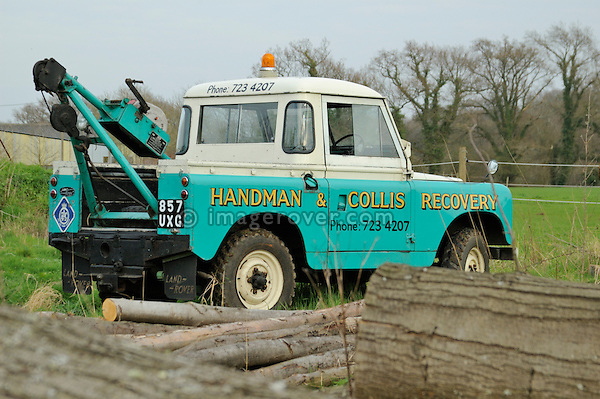 Rear view of 1958 2.0 Liter Diesel Land Rover Series 2 SWB 88 recovery truck with Harvey Frost crane in very original condition with two colour paint sheme in light blue and white showing the golden company name Handman & Collis Recovery. UK 2005 Dunsfold.