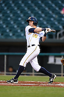 Montgomery Biscuits outfielder Taylor Motter (10) at bat during a game against the Mississippi Braves on April 21, 2014 at Riverwalk Stadium in Montgomery, Alabama.  Montgomery defeated Mississippi 6-2.  (Mike Janes/Four Seam Images)