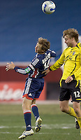 Steve Ralston (NE Revolution, blue) and Eddie Gaven (Columbus Crew, yellow) battle for a head ball. NE Revolution defeat Columbus Crew, 1-0, at Gillette Stadium and secure home field advantage in the Eastern Conference Semifinal Series on October 14, 2006.