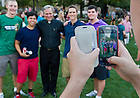 Aug. 27, 2013; Fr. Jenkins poses for a photo with students at the 2013 Opening picnic.<br /> <br /> Photo by Matt Cashore/University of Notre Dame