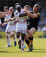 Djibril Camara of Stade Francais is tackled by Tom Palmer of London Wasps during the first leg of the European Rugby Champions Cup play-off match between London Wasps and Stade Francais at Adams Park on Sunday 18th May 2014 (Photo by Rob Munro)