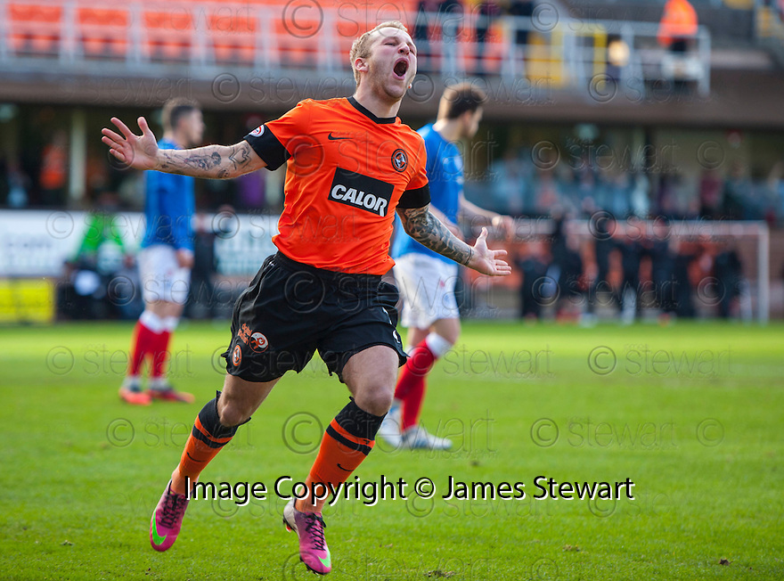 United's Johnny Russell celebrates after he scores united's first.