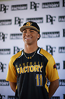 Dominic Johnson (11) of Edmond Santa Fe High School in Edmond, Oklahoma during the Baseball Factory All-America Pre-Season Tournament, powered by Under Armour, on January 12, 2018 at Sloan Park Complex in Mesa, Arizona.  (Zachary Lucy/Four Seam Images)