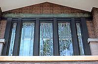 F.L. Wright: Dana House. Windows over main entrance.  Photo '78.