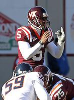 Nov 27, 2010; Charlottesville, VA, USA;  Virginia Tech Hokies quarterback Tyrod Taylor (5) during the game against the Virginia Cavaliers at Lane Stadium. Virginia Tech won 37-7. Mandatory Credit: Andrew Shurtleff-
