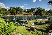 Barton Springs Pool is a naturally fed pool that is about 70 degrees year round that is perfect for a picnic, swim, and a relaxing day in the sun in Zilker Park, Austin, Texas.