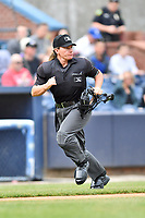 Home plate umpire Jennifer Pawol during a game between the West Virginia Power and the Asheville Tourists at McCormick Field on April 18, 2019 in Asheville, North Carolina. The Power defeated the Tourists 12-7. (Tony Farlow/Four Seam Images)