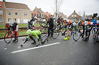 another mass crash with Jack Bauer (NZL/Cannondale-Garmin) reaching for his glasses while others check their bikes. Everybody was able to continue the race after this.<br /> <br /> 77th Gent-Wevelgem 2015