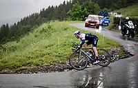 Michael Woods (CAN/Israel Start-Up Nation) descending the Col du Pré (HC/1748m) towards the Barrage de Roselend in, yet again, grim conditions.<br /> <br /> Stage 9 from Cluses to Tignes (145km)<br /> 108th Tour de France 2021 (2.UWT)<br /> <br /> ©kramon