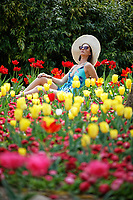 Pictured: Natasha Jenkins enjoys the sunny hot weather at the Botanical Gardens in Swansea, Wales, UK. Thursday 18 April 2019<br /> Re: Warm and sunny weather has been forecast for most of the country throughout the Easter Holiday Weekend.