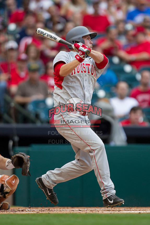 Houston Cougars first baseman Casey Grayson #18 follows through on his swing during the NCAA baseball game against the Texas Longhorns on March 1, 2014 during the Houston College Classic at Minute Maid Park in Houston, Texas. The Longhorns defeated the Cougars 3-2. (Andrew Woolley/Four Seam Images)