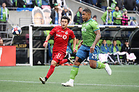 SEATTLE, WA - NOVEMBER 10: Roman Torres #29 of the Seattle Sounders FC and Tsubasa Endoh #31 of Toronto FC chase the ball during a game between Toronto FC and Seattle Sounders FC at CenturyLink Field on November 10, 2019 in Seattle, Washington.