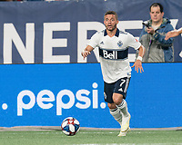 FOXBOROUGH, MA - JULY 18: Lucas Venuto #7 looks to pass during a game between Vancouver Whitecaps and New England Revolution at Gillette Stadium on July 18, 2019 in Foxborough, Massachusetts.