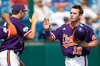 Clemson's Boyd WIlson scores in Game 4 of the NCAA Division One Men's College World Series on Monday June 21st, 2010 at Johnny Rosenblatt Stadium in Omaha, Nebraska.  (Photo by Andrew Woolley / Four Seam Images)