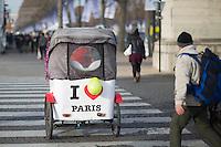 A velo taxi, concept based on the Asian rickshaw, drives tourists through the Place de la Concorde in Paris, France, December 21, 2016. # SECURITE RENFORCEE AU MARCHE DE NOEL DES CHAMPS ELYSEES A PARIS