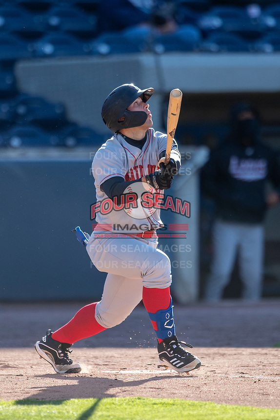 Great Lakes Loons designated hitter Carson Taylor (38) follows through on his swing against the West Michigan Whitecaps at LMCU Ballpark on May 11, 2021 in Comstock Park, Michigan. (Andrew Woolley/Four Seam Images)