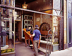 Workers delivering furniture to Post and Beam Reclamation, antique home decor store at the Junction neighbourhood in Toronto, Canada