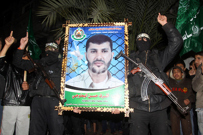 Palestinian Hamas militants take part in a rally in front of the house of the prisoner Ashraf al-Balogei  in Gaza City on Feb. 7,2011. Photo by Mohammed Asad