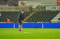 A Swansea groundsman tends to the pitch in the wet conditions ahead of the Premier League match between Swansea City and Southampton at The Liberty Stadium, Swansea, Wales, UK. Tuesday 31 January 2017