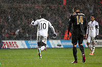 Wednesday, 01 January 2014<br /> Pictured: Wilfried Bony of Swansea (10) celebrating his second goal, reducing the difference to 3-2 for the visitors.<br /> Re: Barclay's Premier League, Swansea City FC v Manchester City at the Liberty Stadium, south Wales.