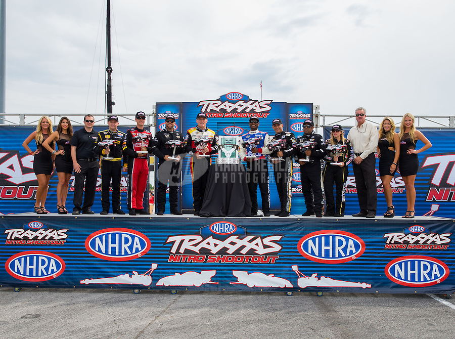 Aug 30, 2014; Clermont, IN, USA; Posing with the Traxxas Trophy for qualifying to race in the Traxxas Top Fuel Nitro Shootout is NHRA top fuel dragster drivers (L-R) Richie Crampton, Spencer Massey, Shawn Langdon, Doug Kalitta, Antron Brown, Tony Schumacher, Khalid Albalooshi and Brittany Force at the drivers introduction during qualifying for the US Nationals at Lucas Oil Raceway. Mandatory Credit: Mark J. Rebilas-USA TODAY Sports
