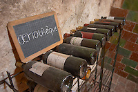 old bottles in the cellar chalk board mas du notaire rhone france