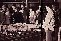 """China:  Han--an exhibit,  """"The People receive class education here. Visitors view the Jade Burial Suit of Liu  Sheng."""""""