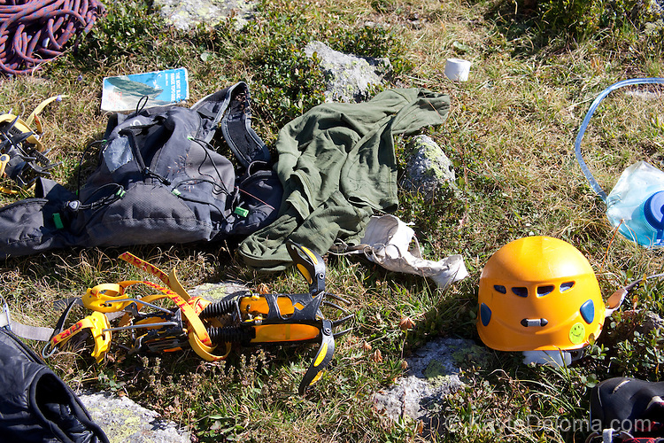 Mountain climbing gear laid out for packing on the Plan D'Aiguille, midway up the mountain from Chamonix to the Aiguille du Midi, Chamonix-Mont-Blanc, France