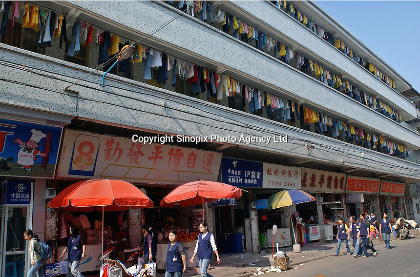 The street dormitories of Mattel workers at the Changan plant that makes Barbie dolls in Guangdong Province, China..02-DEC-04