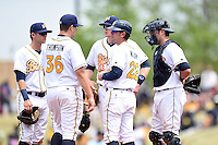 Montgomery Biscuits manager Brady Williams (22) makes a pitching change bringing in pitcher Jake Thompson (36) as shortstop Jake Hager (2), first baseman Cameron Seitzer (33) and catcher Luke Maile (21) look on during a game against the Mississippi Braves on April 22, 2014 at Riverwalk Stadium in Montgomery, Alabama.  Mississippi defeated Montgomery 6-2.  (Mike Janes/Four Seam Images)