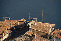 - Iseo lake, the roofs of Carzano village on Montisola island   ....- Lago d'Iseo, i tetti del paese di Carzano sull'isola Montisola..