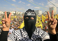 """Palestinian Fatah mask woman  supporters gather at a rally marking the third anniversary of the death of the late Palestinian leader Yasser Arafat in Gaza City, Monday, Nov. 12, 2007. Hamas security forces opened fire at a mass rally commemorating the death of the late Palestinian leader, violently dispersing the largest public display of support for the rival Fatah movement since Hamas seized control of the Gaza Strip in June. Five people were killed and at least 31 were wounded, medical officials and Fatah said.""""photo by Fad Adwan"""""""