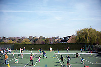 Parents and their children warm up for a coaching session with Dan Bloxham as part of the Junior Tennis initiative at Wimbledon, The All England Lawn Tennis Club (AELTC), London..