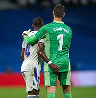 25th September 2021; Estadio Santiagp Bernabeu, Madrid, Spain; Men's La Liga, Real Madrid CF versus Villarreal CF; Courtois and Alaba hug each other after the match