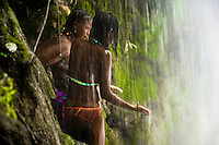 Haitian women perform a bathing and cleaning ritual, using the aromatic herbs, under the waterfall during the annual religious pilgrimage in Saut d'Eau, Haiti, July 16, 2008. Every year in summer thousands of pilgrims from all over Haiti make the religious journey to the Saut d'Eau waterfall (100km north of Port-au-Prince). It is believed that 150 years ago the spirit of Virgin Mary (Our Lady of Mount Carmel) has appeared on a palm tree close to the waterfall. This place became a main pilgrimage site in Haiti since then. Haitians wearing only underwear perform a bathing and cleaning ritual under the 100-foot-high waterfall. Voodoo followers (many Haitians practise both voodoo and catholicism) hope that Erzulie Dantor, the Voodoo spirit of water, manifest itself and they get possessed for a short moment, touched by her presence.