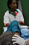 A patient being comforted during an endoscopy at Gisenyi District Hospital, Rwanda