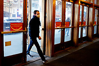 NEW YORK, NEW YORK - MARCH 05: A man enter to AMC Cinema in Times Square on March 05, 2021, in New York. NY Governor, Andrew Cuomo gave the permission to reopen cinemas on Feb. 22 at 25% capacity, or a maximum of 50 people per show. (Photo by John Smith/VIEWpress)