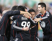 Andy Najar #14 and Branko Boskovic #27 of D.C. United hug Jaime Moreno #99 after he had scored during an MLS match against Toronto FC that was the final appearance of D.C. United's Jaime Moreno at RFK Stadium, in Washington D.C. on October 23, 2010. Toronto won 3-2.