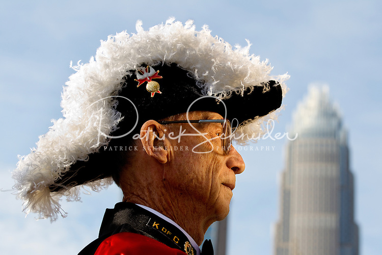 Photography of the Charlotte NC St. Patrick's Day Parade in March 2012. Image shows Vic St. Pierre with the Knights of Columbus. Photography is part of a series of St. Patrick's Day Parade photos in Charlotte, NC.
