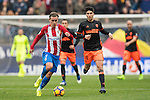 Antoine Griezmann of Atletico de Madrid (left)runs with the ball while Carlos Soler of Valencia CF is in pursuit during the match Atletico de Madrid vs Valencia CF, a La Liga match at the Estadio Vicente Calderon on 05 March 2017 in Madrid, Spain. Photo by Diego Gonzalez Souto / Power Sport Images