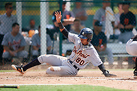 Detroit Tigers shortstop Wenceel Perez (80) slides home during a Florida Instructional League game against the Pittsburgh Pirates on October 2, 2018 at the Pirate City in Bradenton, Florida.  (Mike Janes/Four Seam Images)