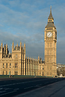 Palace of Westminster (Houses of Parliament) and Big Ben clock tower (Elizabeth Tower) behind an empty Westminster Bridge in London, England, UK.