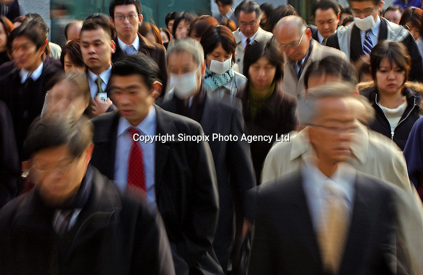 Businessmen make their way to work in Tokyo's main business and financial district , Tokyo, Japan..03 Jan 2005
