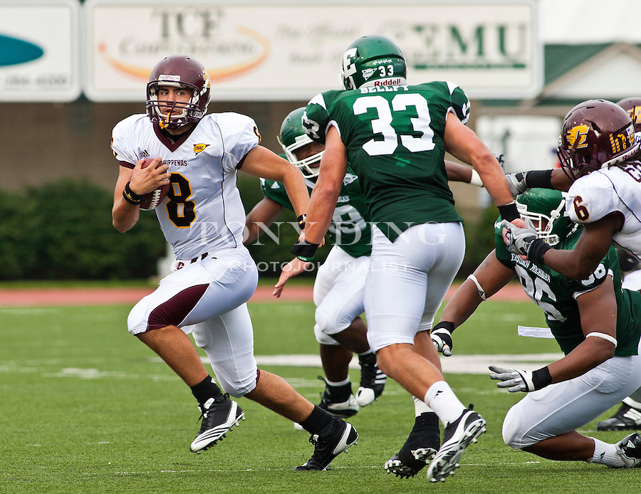Central Michigan quarterback Ryan Radcliff (8) rushes past Eastern Michigan cornerback Alex Bellfy (33) in the second quarter of an NCAA college football game, Saturday, Sept. 18, 2010, in Ypsilanti, Mich. (AP Photo/Tony Ding)