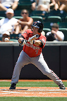 Designated Hitter Nick Popescu #7 of the Texas Tech Red Raiders bunts against the Texas Longhorns on April 17, 2011 at UFCU Disch-Falk Field in Austin, Texas. (Photo by Andrew Woolley / Four Seam Images)