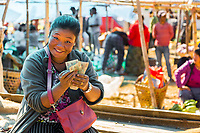 Punakha, Bhutan.  Woman Counting her Money in the  Fruit and Vegetable Market.