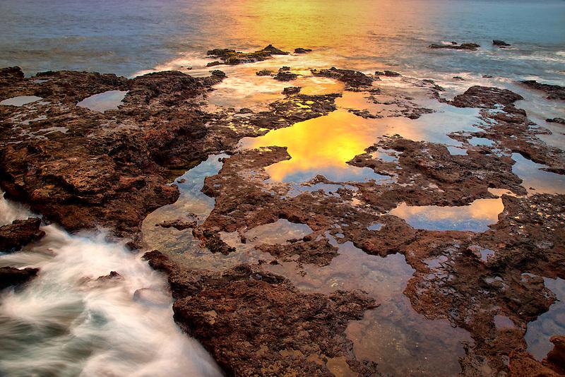 Sunset reflection at low tide. Lanai, Hawaii.