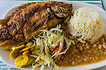 A typical meal of fried fish and coconut rice in the Caribbean coastal region of Colombia.
