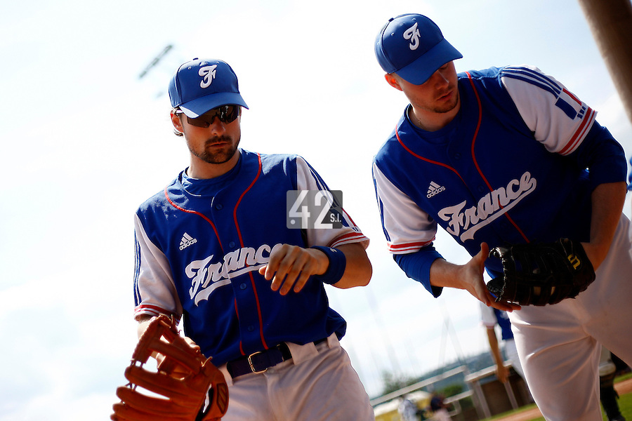 25 June 2011: Florian Peyrichou and Anthony Cros of Team France. Illustration of a photographic essay called Life in the dugout, during Czech Republic 11-1 win over France, at the 2011 Prague Baseball Week, in Prague, Czech Republic.